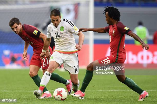 TOPSHOT Mexico's forward Javier Hernandez vies with Portugal's defender Cedric and Portugal's forward Gelson Martins during the 2017 Confederations...