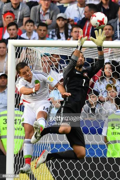 TOPSHOT Mexico's forward Javier Hernandez vies with Portugal's goalkeeper Rui Patricio during the 2017 Confederations Cup group A football match...