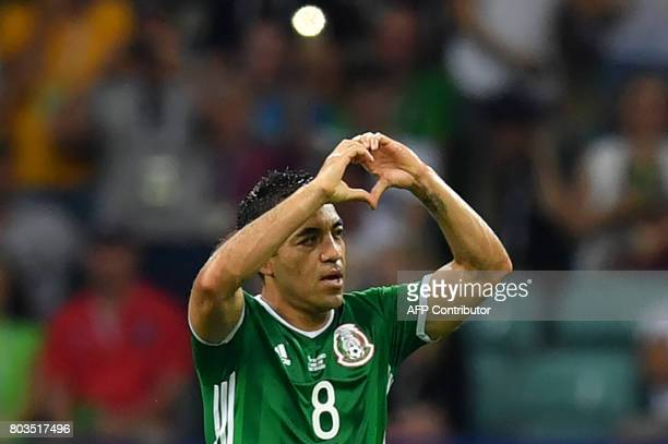 TOPSHOT Mexico's forward Marco Fabian celebrates after scoring a goal during the 2017 FIFA Confederations Cup semifinal football match between...