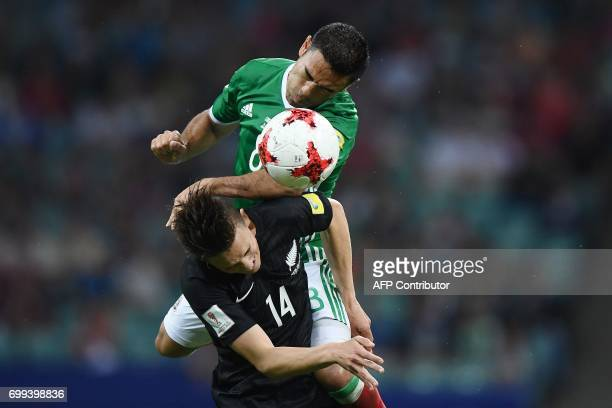 Mexico's forward Marco Fabian vies with New Zealand's midfielder Ryan Thomas during the 2017 Confederations Cup group A football match between Mexico...