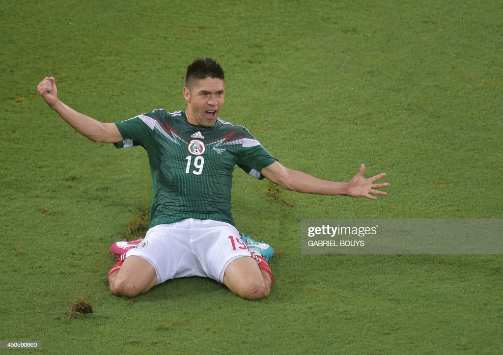 Mexico's forward Oribe Peralta celebrates after scoring a goal during the Group A football match between Mexico and Cameroon at the Dunas Arena in Natal during the 2014 FIFA World Cup on June 13, 2014. AFP PHOTO / GABRIEL BOUYS / AFP PHOTO / Gabriel BOUYS
