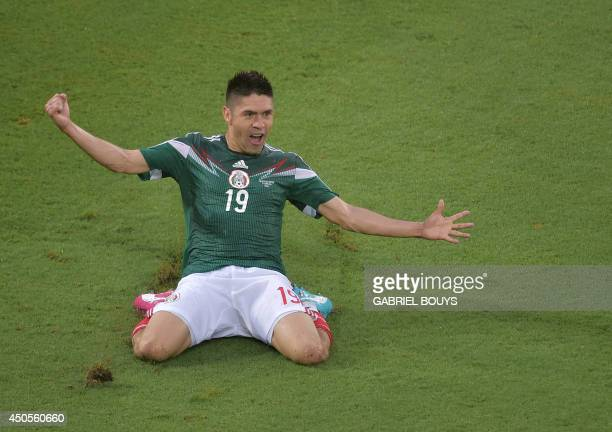 Mexico's forward Oribe Peralta celebrates after scoring a goal during the Group A football match between Mexico and Cameroon at the Dunas Arena in...