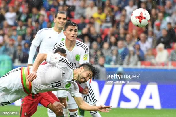 TOPSHOT Mexico's forward Oribe Peralta dives to head the ball during the 2017 FIFA Confederations Cup third place football match between Portugal and...