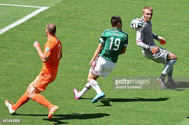 Mexico's forward Oribe Peralta vies with Netherlands' defender Ron Vlaar and Netherlands' goalkeeper Jasper Cillessen during a Round of 16 football...