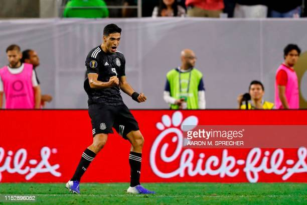 Mexico's forward Raul Jimenez celebrates after scoring a goal during the CONCACAF Gold Cup Quarterfinal football match between Mexico and Costa Rica...