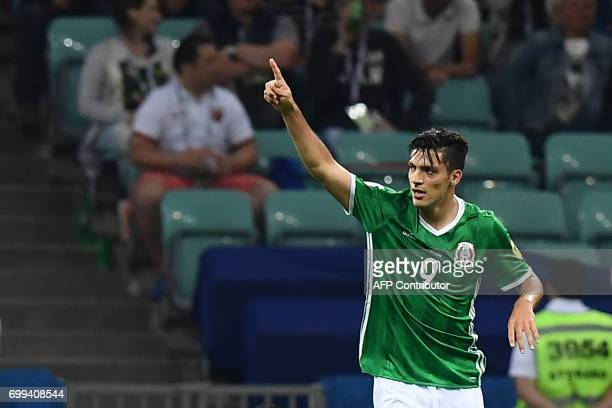 Mexico's forward Raul Jimenez celebrates after scoring a goal during the 2017 Confederations Cup group A football match between Mexico and New...