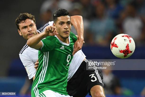TOPSHOT Mexico's forward Raul Jimenez challenges Germany's defender Jonas Hector during the 2017 FIFA Confederations Cup semifinal football match...