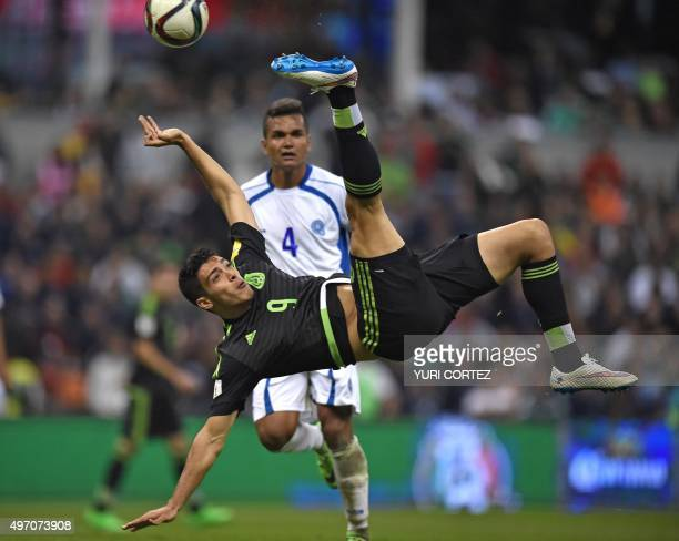 Mexico's forward Raul Jimenez kicks the ball next to El Salvador's defender Henry Romero during their Russia 2018 FIFA World Cup CONCACAF Qualifiers...