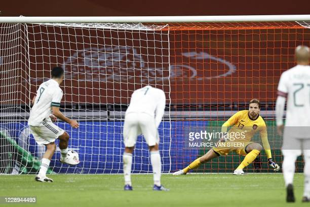 Mexico's forward Raul Jimenez shoots and scores a penalty against Netherlands' goalkeeper Tim Krul during the friendly match between the Netherlands...