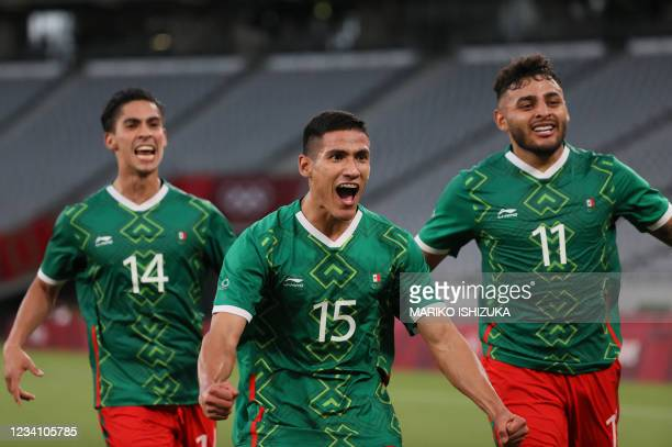 Mexico's forward Uriel Antuna celebrates with Mexico's forward Alexis Vega and Mexico's midfielder Erick Aguirre after scoring the third goal during...