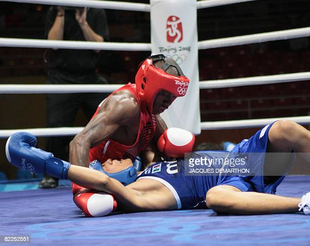 Mexico's Francisco Vargas and Madagascar's Jean de Dieu Soloniaina fall during their 2008 Olympic Games Lightweight boxing match on August 11, 2008...