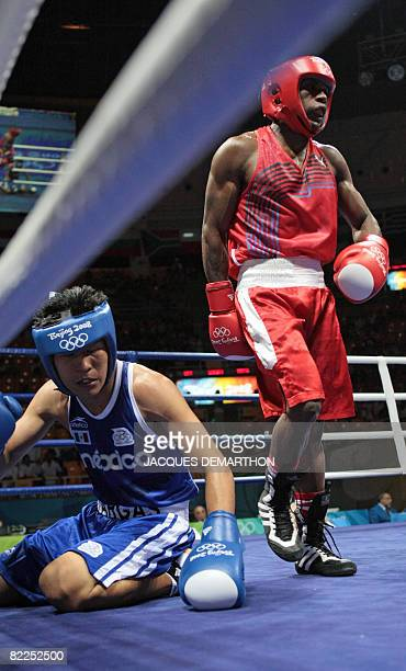Mexico's Francisco Vargas falls into the ropes against Madagascar's Jean de Dieu Soloniaina during their 2008 Olympics Games Lightweight boxing match...