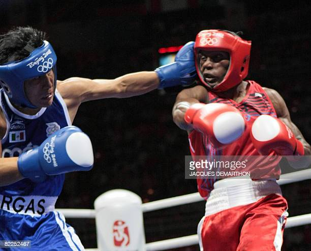 Mexico's Francisco Vargas fights against Madagascar's Jean de Dieu Soloniaina during their 2008 Olympic Games Lightweight boxing bout on August 11,...