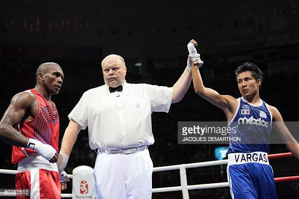 Mexico's Francisco Vargas is declared winner after defeating Madagascar's Jean de Dieu Soloniaina during their 2008 Olympic Games Lightweight boxing...