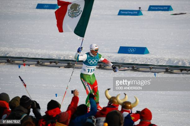 Mexico's German Madrazo crosses the finish line in the men's 15km cross country freestyle at the Alpensia cross country ski centre during the...