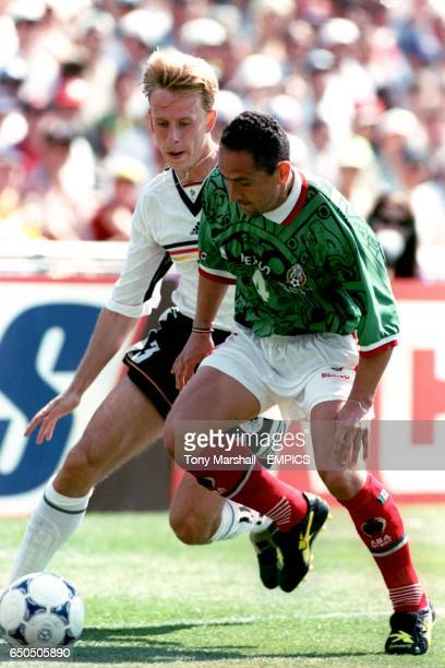 Mexico's German Villa and Germany's Jorg Heinrich battle for the ball