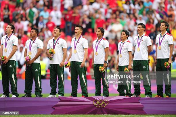 Mexico's Giovani Dos Santos and teammates during their national anthem as they celebrate victory in the Football Men's Gold Medal Match between...