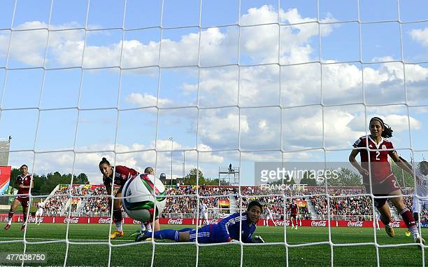 Mexico's goalkeeper Cecilia Santiago eyes the ball after a goal of England's forward Fran Kirby during a Group F match at the 2015 FIFA Women's World...