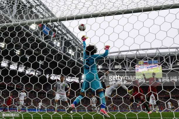 TOPSHOT Mexico's goalkeeper Guillermo Ochoa blocks a shot on goal during the 2017 FIFA Confederations Cup third place football match between Portugal...