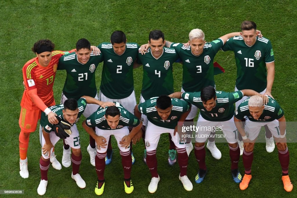 Mexico's goalkeeper Guillermo Ochoa, Mexico's defender Edson Alvarez, Mexico's defender Hugo Ayala, Mexico's midfielder Rafael Marquez, Mexico's defender Carlos Salcedo, Mexico's midfielder Hector Herrera, (FRONT L-R) Mexico's forward Hirving Lozano, Mexico's midfielder Andres Guardado, Mexico's defender Jesus Gallardo, Mexico's forward Carlos Vela and Mexico's forward Javier Hernandez pose before the Russia 2018 World Cup round of 16 football match between Brazil and Mexico at the Samara Arena in Samara on July 2, 2018. (Photo by Kirill KUDRYAVTSEV / AFP) / RESTRICTED
