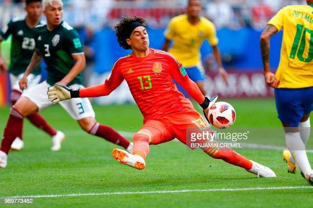 Mexico's goalkeeper Guillermo Ochoa stops a ball during the Russia 2018 World Cup round of 16 football match between Brazil and Mexico at the Samara...