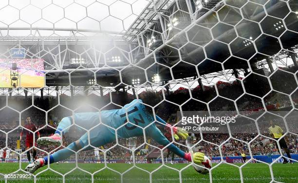 Mexico's goalkeeper Guillermo Ochoa stops a penalty kick by Portugal's forward Andre Silva during the 2017 FIFA Confederations Cup third place...
