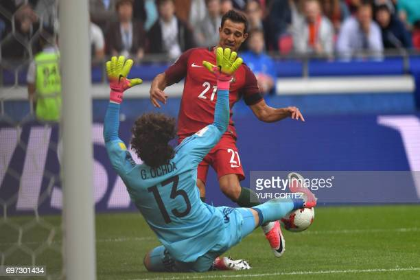 TOPSHOT Mexico's goalkeeper Guillermo Ochoa stops the ball as Portugal's defender Cedric tries to score during the 2017 Confederations Cup group A...