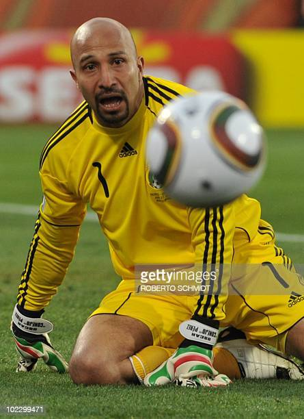 Mexico's goalkeeper Oscar Perez eyes the ball during their Group A first round 2010 World Cup football match on June 22 2010 at Royal Bafokeng...