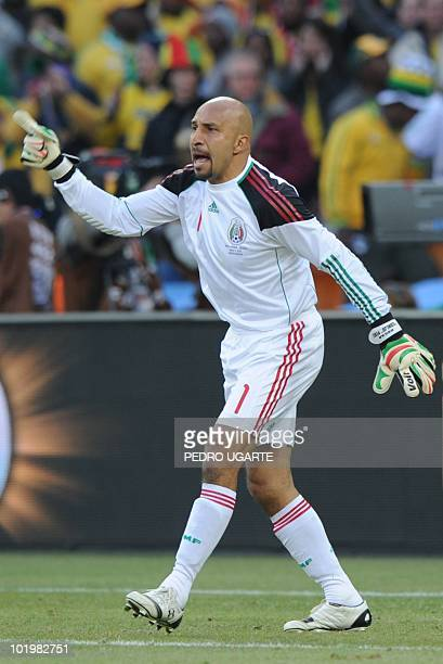 Mexico's goalkeeper Oscar Perez gestures during their Group A first round 2010 World Cup football match on June 11 2010 at Soccer City stadium in...