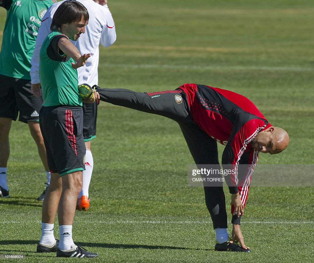 Mexico's goalkeeper Oscar Perez (R) make streching exercises with physical trainer Juan Iribarren during a training session of the Mexico national football team at the Waterstone College in Johannesburg on June 6, 2010. The 2010 World Cup will take place in South Africa from June 11 to July 11, the first time on African soil for the biggest and most prestigious competition in sport.