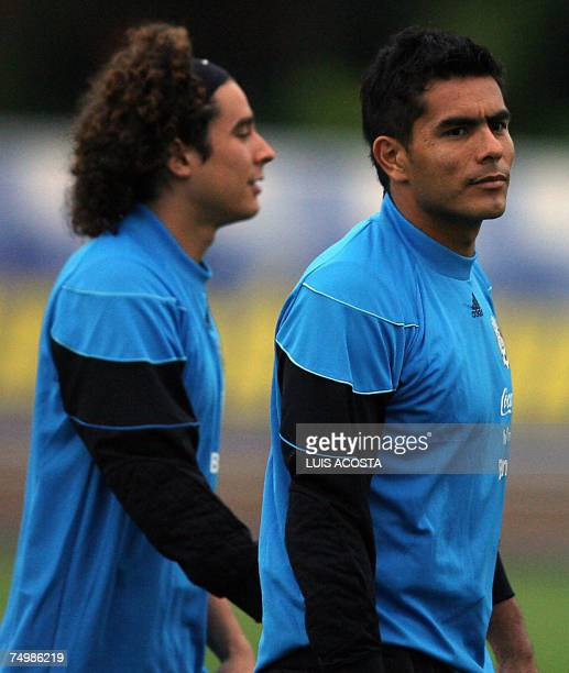 Mexico's goalkeepers Guillermo Ochoa and Oswaldo Sanchez take part of a training session of the Copa America 2007 in Puerto La Cruz Venezuela on July...