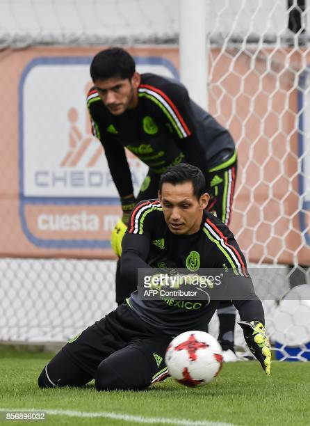 Mexico's goalkeepers Rodolfo Cota and Jesus Corona attend a training session on October 02 2017 in Mexico City ahead of their upcoming 2018 FIFA...