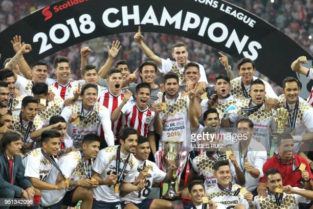 Mexico's Guadalajara players hold their trophy following victory over Canada's Toronto FC in their final second leg football match of the CONCACAF...