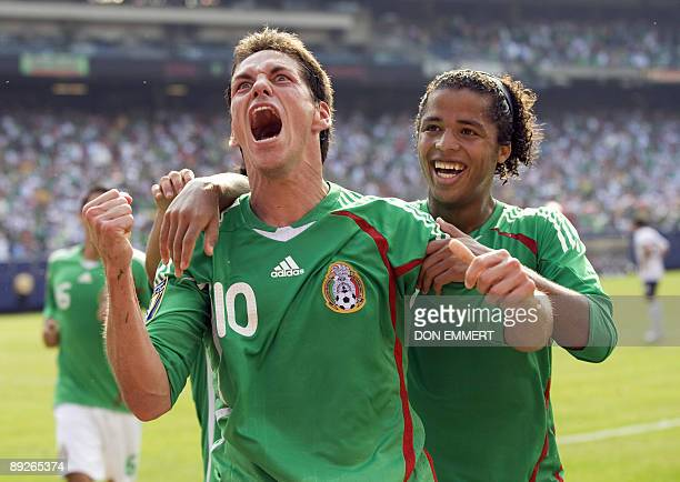 Mexico's Guillermo Franco and Giovani Dos Santos celebrate Franco's goal against the US during the finals of the CONCACAF Gold Cup soccer tournament...