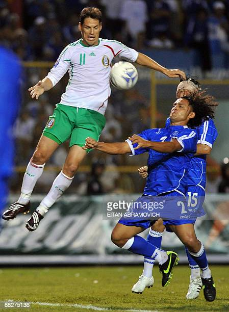 Mexico's Guillermo Franco vies for the ball with El Salvador's Alexander Escobar during their FIFA World Cup South Africa2010 qualifier football...