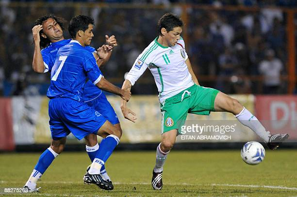Mexico's Guillermo Franco vies for the ball with El Salvador's Ramon Sanchez and Alexander Escobar during their FIFA World Cup South Africa2010...