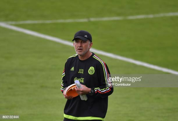 Mexico's head coach Colombian Juan Carlos Osorio attends a training session at the Central Stadium in Kazan on June 23 2017 on the eve of the Russia...