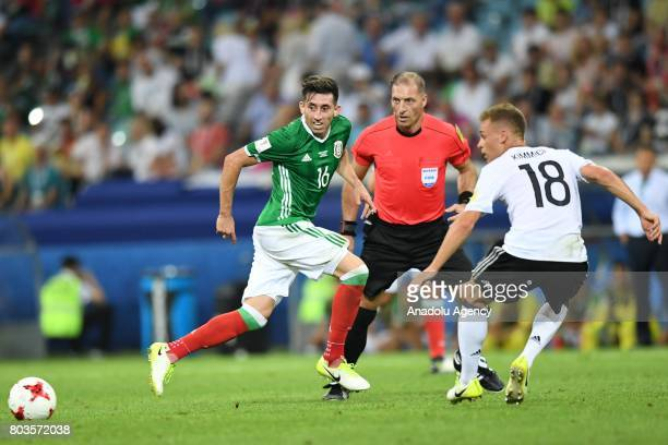 Mexico's Hector Herrera and Germany's Joshua Kimmich during match the FIFA Confederations Cup 2017 between Germany and Mexico in Sochi Russia on June...