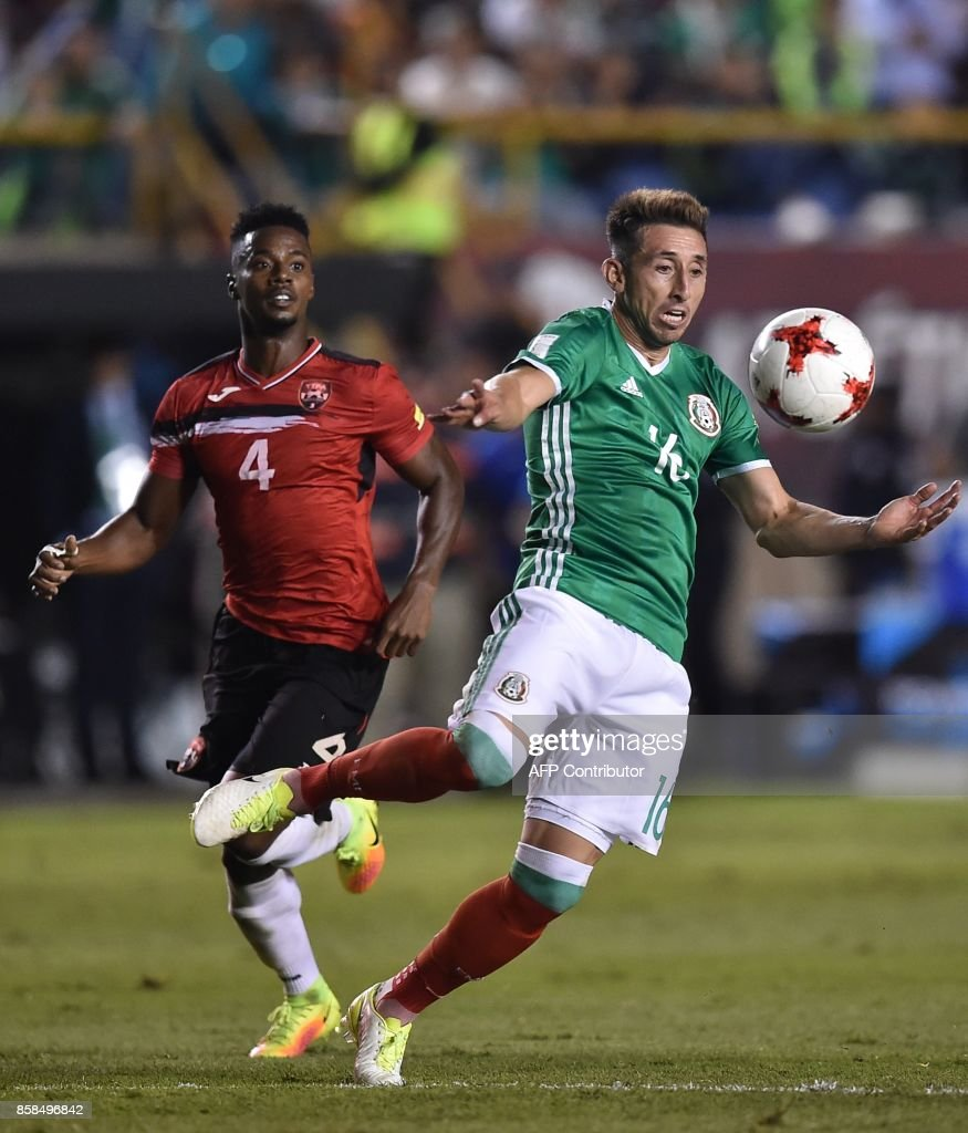 Mexico's Hector Herrera (R) and Trinidad and Tobago's Kevon Villaroel vie for the ball during their 2018 World Cup qualifier football match in San Luis Potosi, Mexico, on October 6, 2017. /