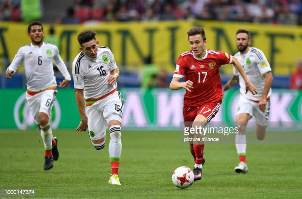 Mexico's Hector Herrera Russia's Alexandr Golovin vie for the ball during the group stage match pitting Mexico against Russia at the Kazan Arena in...