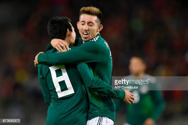 Mexico's Hirving Lozano celebrates with Mexico's midfielder Hector Herrera after scoring a goal during the international friendly football match...