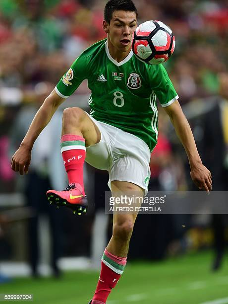 Mexico's Hirving Lozano controls the ball during their Copa America Centenario football tournament match against Venezuela in Houston Texas United...