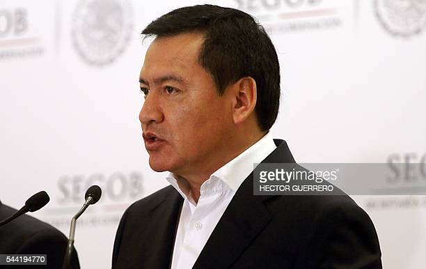 Mexico's Interior Minister Miguel Angel Osorio Chong offers a press conference regarding the standoff with teachers protesting education reforms that...