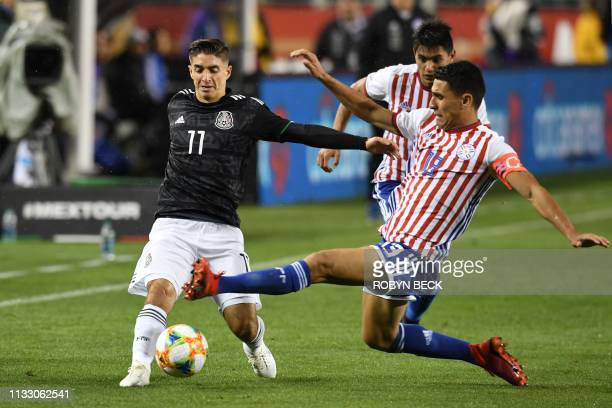 Mexico's Isaac Brizuela fights for the ball with Paraguay's Junior Alonso during the international friendly match between Mexico and Paraguay at...