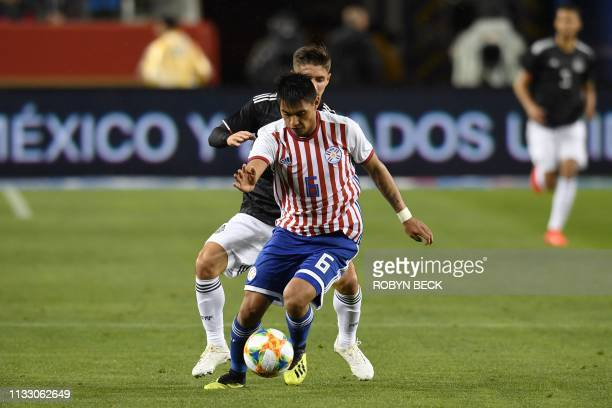 Mexico's Isaac Brizuela fights for the ball with Paraguay's Santiago Arzamendia during the international friendly match between Mexico and Paraguay...