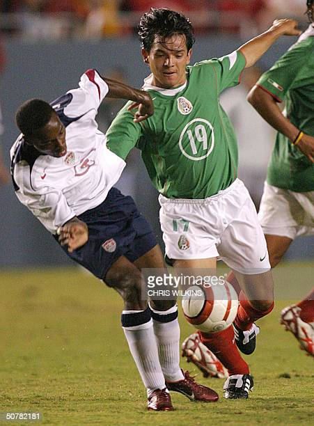 Mexico's Israel Lopez tries to take the ball from DeMarcus Beasley of the US during the international friendly men's soccer match between the United...