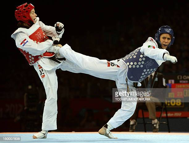 Mexico's Jannet Alegria Pena fights against Croatia's Lucija Zaninovic during their women's taekwondo bronze medal bout in the category under 49 kg...