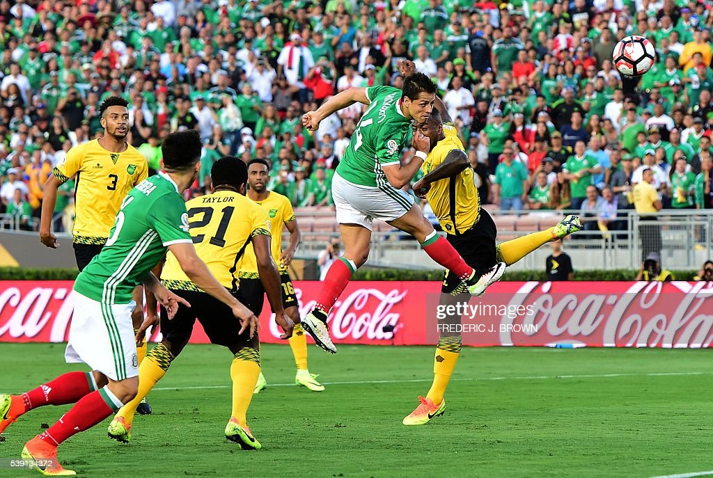 TOPSHOT - Mexico's Javier 'Chicharito' Hernandez (2-R) scores a header against Jamaica during their Copa America Centenario football tournament match in Pasadena, California, United States, on June 9, 2016. / AFP / Frederic J. Brown