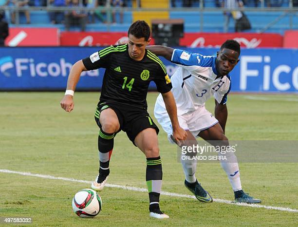 Mexico's Javier Hernandez and Honduras' Maynor Figueroa vie for the ball during the Russia 2018 FIFA World Cup Concacaf Qualifiers football match in...