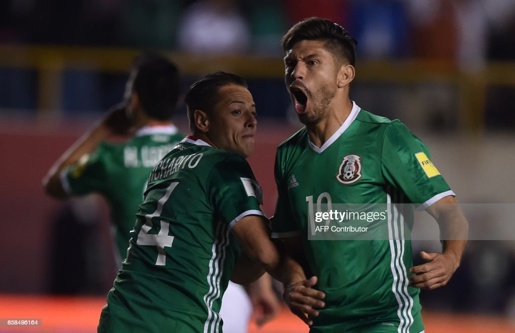 Mexico's Javier Hernandez (L) celebrates with Mexico's Oribe Peralta after scoring against Trinidad and Tobago, during their 2018 World Cup qualifier football match in San Luis Potosi, Mexico, on October 6, 2017. /